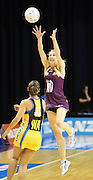 Clare McMeniman takes the ball up high ahead of Francis Solia. ANZ Netball Championship. Round 3 - Queensland Firebirds v Central Pulse. Played at Brisbane Convention Centre. Firebirds (56) defeated the Pulse (28).  Photo: Warren Keir (SMP/Photosport NZ).<br /> <br /> Use information: This image is intended for Editorial use only (e.g. news or commentary, print or electronic). Any commercial or promotional use requires additional clearance.
