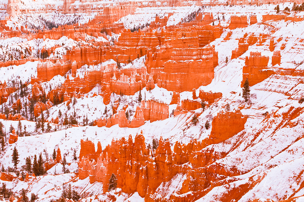 Evening light on snow-dusted rock formations below Sunset Point, Bryce Canyon National Park, Utah USA