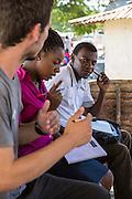 ICS volunteers Joe Radcliffe, Francisca Mlingwa and Goodluck Sanga visiting Mnyangu Sofa Seat a local sofa making company, part of the VSO / ICS Elimu Fursa project (Opportunities in Education) Lindi, Lindi region. Tanzania.