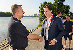 © Licensed to London News Pictures. 15/07/2013 London, UK. Deputy Prime Minister, Nick Clegg, is given a gold medal from the 2010 Gay Games in Cologne by David Killian, site chairman of the Federation of Gay Games. The group are in London to assess the cities potential for holding the 2018 Gay Games. Barn Elms Boathouse, Barnes, London.<br /> Photo credit : Simon Jacobs/LNP