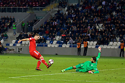 TBILSI, GEORGIA - Friday, October 6, 2017: Wales' Sam Vokes and Georgia's goalkeeper Giorgi Loria during the 2018 FIFA World Cup Qualifying Group D match between Georgia and Wales at the Boris Paichadze Dinamo Arena. (Pic by David Rawcliffe/Propaganda)