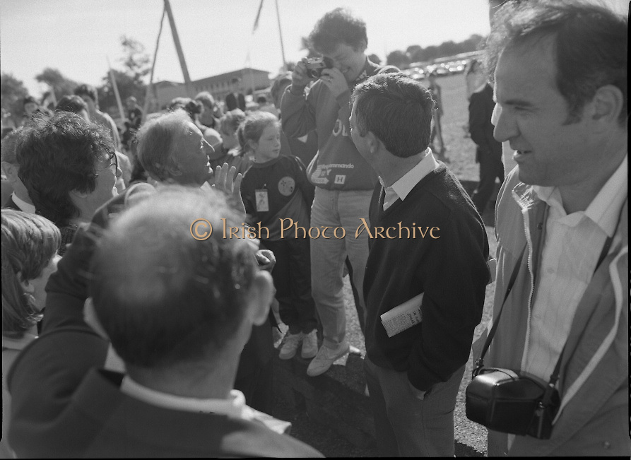 Charles Haughey Visits The Community Games. (T5)..1989..03.10.1989..10.03.1989..3rd September 1989..An Taoiseach, Charles Haughey TD,accompanied by Mr Frank Fahey, TD, Minister of State with responsibility for Youth and Sport attended the Twentieth National Finals of the Community Games at Mosney,  Co.Meath yesterday...Image shows a young admirer taking a picture of An Taoiseach,Charles Haughey TD.