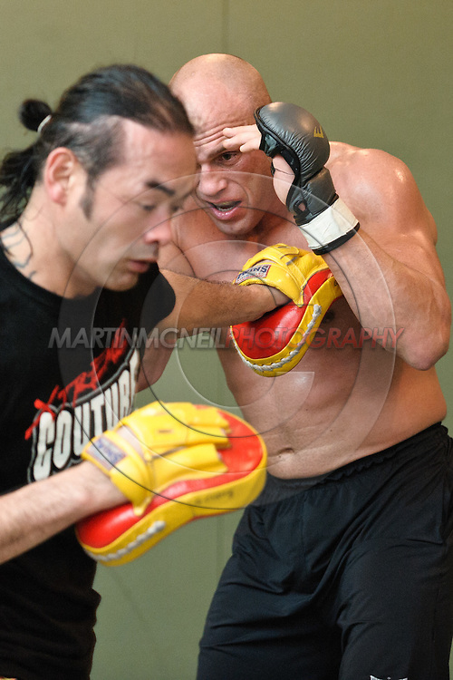 Randy Couture (facing) and Quentin Chong work on muay thai striking defence during a pre-fight training session at Straight Blast Gym ahead of UFC 105 in Manchester, England on November 12, 2009.