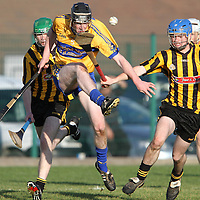 """Conlioth Agnew Sixmilebridge display's his football skills as he kicks clear during the Minor """"A"""" Hurling Final against Ballyea. - Photograph by Flann Howard"""