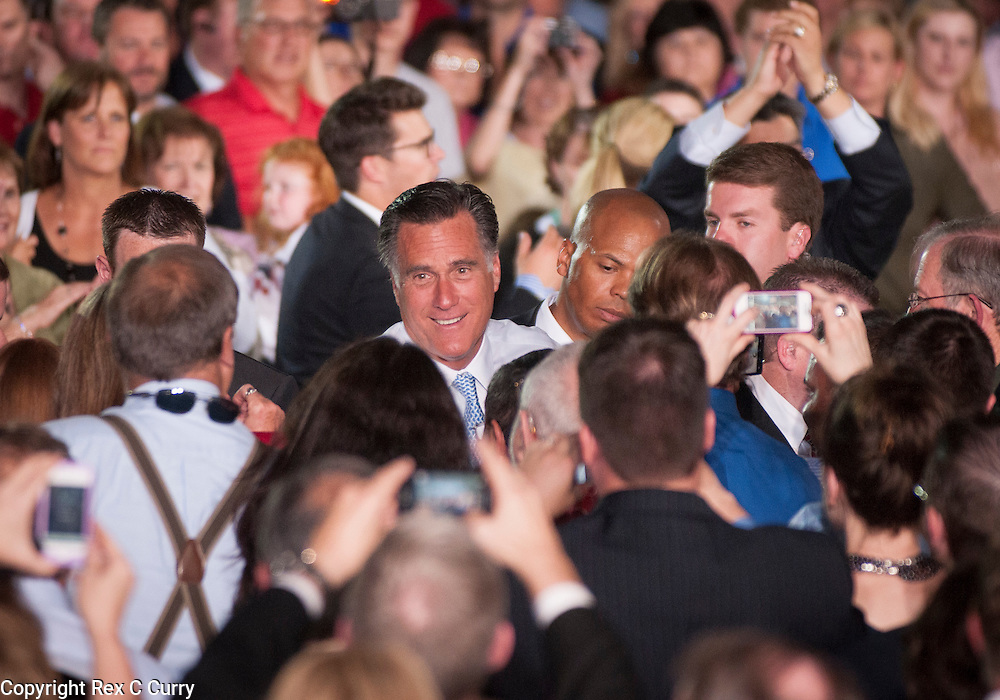 Republican presidential nominee Mitt Romney shakes hands with supporters after speaking  to a crowd of over 500 at Southwest Office Systems in Fort Worth, Tx. Tuesday, June 5, 2012.