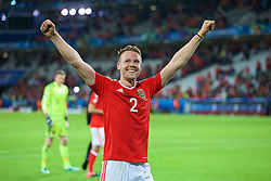 LILLE, FRANCE - Friday, July 1, 2016: Wales' Chris Gunter salutes the supporters as they celebrate the 3-1 victory against Belgium at full time after the UEFA Euro 2016 Championship Quarter-Final match at the Stade Pierre Mauroy. (Pic by Paul Greenwood/Propaganda)