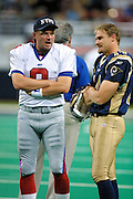 Kicker Morten Andersen (8) of the New York Giants and Kicker Jeff Wilkins (14) of the St. Louis Rams talk before a game in a 15 to 14 win by the Rams on 10/14/2001..©Wesley Hitt/NFL Photos