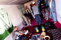 "YAFTAL PAYAN, 31 July 2005..German soldiers take their boots off before having food at the Bitha Bala's guest house...They came here to meet the head of the village who, apparently, is not there...Ralph - on the left - says that their duty is to look at the life conditions of the villagers and to report it to the reconstruction team. ..""The aim is to cooordinate the work of all NGOs operating in Afghanistan"" he adds."