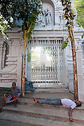 Afternoon siesta on the steps of the Ramanathan Hindu Kovil on Good Friday afternoon.