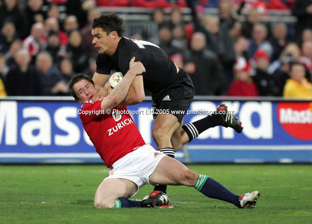 Daniel Carter pushes down Shane Williams during the 2nd test match between the All Blacks and the British and Irish Lions at Westpac Stadium, Wellington, New Zealand on Saturday 2 July, 2005. The All Blacks won the match 48 - 18 to win the series. Photo: Hannah Johnston/PHOTOSPORT