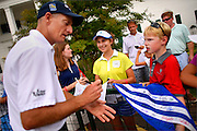Jim Furyk signs autographs for a group of young fans during the final round of the Barclays Championship held at Plainfield Country Club in Edison, New Jersey on August 30.