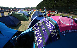 A general view of official towels on tents as spectators queue at the start of day five of the Wimbledon Championships at the All England Lawn Tennis and Croquet Club, Wimbledon.