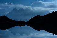 Reflexions of Dent du Geant, Les Aiguilles de Chamonix and L'Aiguille du Midi in the Lac Blanc at night with clouds and moonshine, Chamonix, France / Impressionen bei den Lacs des Cheserys oberhalb von Chamonix, Mont-Blanc, an einem Spätsommertag im September