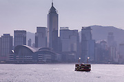 A harbour ferry crossing from Kowloon to the island of Hong Kong - in the background