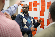 IHG executives participate in problem solving work sessions