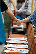 Delegates join hands for an opening prayer at the Iowa Democratic Party's state convention at the Iowa Events Center-Hy-Vee Hall in Des Moines on Saturday, June 18, 2016. Delegates to the Iowa Democratic Convention will elect a total of 15 national convention delegates at the convention using a handheld electronic device. Iowa's delegation to the DNC consists of 51 delegates and four alternates. (Rebecca F. Miller/The Gazette)
