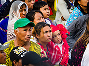 29 NOVEMBER 2017 - YANGON, MYANMAR:  People watch Pope Francis on large TV screens set up around the grounds of the Papal Mass. Hundreds of thousands of Catholics from Myanmar attended the mass said by Pope Francis at Kyaikkasan Sports Ground in Yangon Wednesday. Pope Francis is on the first visit by a Pope to Myanmar.   PHOTO BY JACK KURTZ