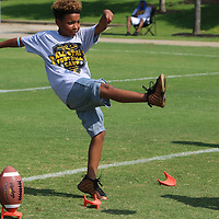 Jaylen Bohanna, 8, practices kicking off Saturday during the All-Star Football Camp benefiting the Boys and Girls Clubs of North Mississippi