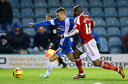 Peterborough United's Daniel Kearns in action with Swindon Town's Dany N'Guessan - Photo mandatory by-line: Joe Dent/JMP - Tel: Mobile: 07966 386802 05/02/2014 - SPORT - FOOTBALL - Peterborough - London Road Stadium - Peterborough United v Swindon Town - Johnstone's Paint Trophy