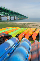 Mackinac Bridge and colorful rental kayaks,Mackinaw City Michigan