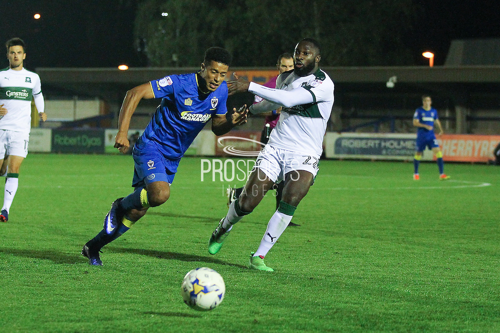 AFC Wimbledon striker Lyle Taylor (33) and Plymouth Argyle striker David Ijaha (22) during the EFL Trophy match between AFC Wimbledon and Plymouth Argyle at the Cherry Red Records Stadium, Kingston, England on 4 October 2016. Photo by Stuart Butcher.