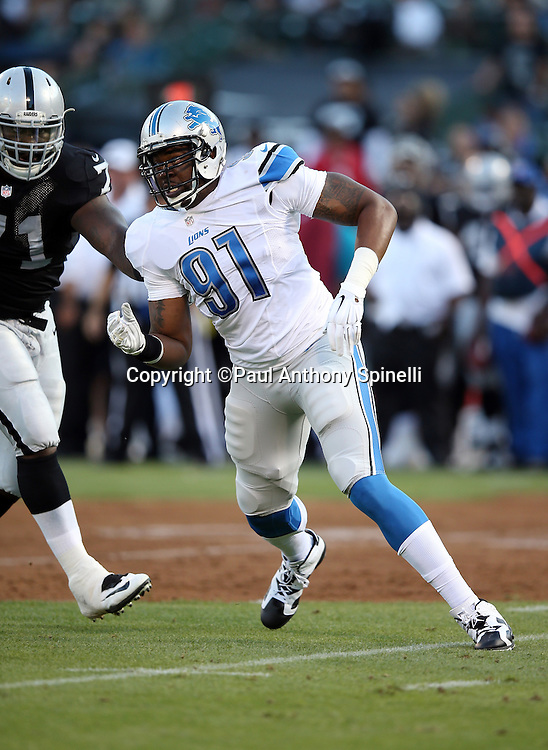 Detroit Lions defensive end Jason Jones (91) chases the action during the 2014 NFL preseason football game against the Oakland Raiders on Friday, Aug. 15, 2014 in Oakland, Calif. The Raiders won the game 27-26. ©Paul Anthony Spinelli