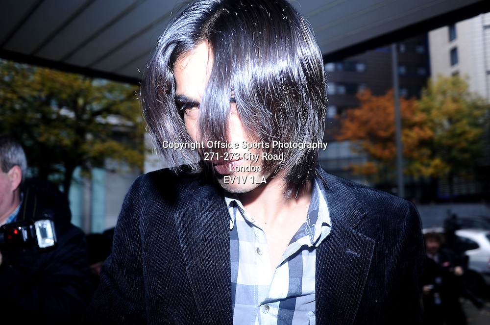 03/11/2011 - Pakistan cricketers match fixing sentence - Crown Court Southwark London - Mohammad Amir makes his way through the media to court. - Photo: Charlie Crowhurst / Offside.
