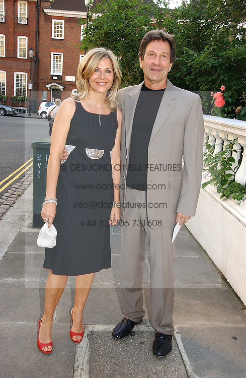 Actor MICHAEL BRANDON his wife actress GLYNIS BARBER at Sir David &amp; Lady Carina Frost's annual summer party held in Carlyle Square, Chelsea, London on 5th July 2006.<br />