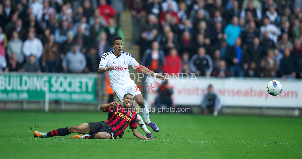 SWANSEA, WALES - Sunday, March 11, 2012: Swansea City's Scott Sinclair tries to score from the half-way line as the Manchester City players and goalkeeper swarm forward in injury time during the Premiership match at the Liberty Stadium. (Pic by David Rawcliffe/Propaganda)