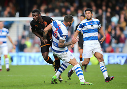 Wolves Bright Enobakhare is fouled by QPR's Joel Lynch during the Sky Bet Championship match at Loftus Road, London.
