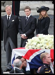 Sir Mark Thatcher and his children Michael and Amanda watch Baroness Thatcher's coffin leaving  St.Paul's Cathedral in London , Wednesday 17th  April 2013 Photo by: Stephen Lock / i-Images