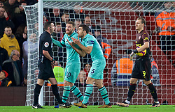 LIVERPOOL, ENGLAND - Saturday, December 29, 2018: Arsenal's Shkodran Mustafi and Sokratis Papastathopoulos argue with referee Michael Oliver after he awarded Liverpool a penalty during the FA Premier League match between Liverpool FC and Arsenal FC at Anfield. (Pic by David Rawcliffe/Propaganda)