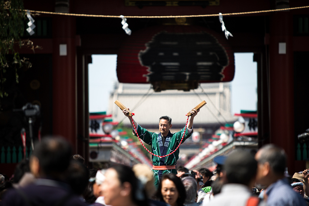 TOKYO, JAPAN - MAY 21: A man clap with a hardwood as he participate in parade during the Sanja Festival in Asakusa, Tokyo on May 21, 2017. These mikoshi (portable shrine) is carried in the streets of Asakusa to bring luck, blessings and prosperity to the area and its inhabitants. (Photo: Richard Atrero de Guzman/NUR Photo)