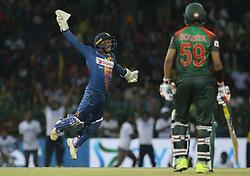 March 16, 2018 - Colombo, Sri Lanka - Sri Lankan cricketer Kusal Perera (L) leaps in the air after taking a catch to dismiss Bangladesh's Tamim Iqbal (unseen) during the 6th T20 cricket match of NIDAHAS Trophy between Sri Lanka  and Bangladesh at R Premadasa cricket ground, Colombo, Sri Lanka on Friday 16 March 2018. (Credit Image: © Tharaka Basnayaka/NurPhoto via ZUMA Press)