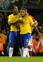 Photo: Ed Godden.<br /> Brazil v Wales. International Friendly. 05/09/2006.<br /> Ronaldinho (L) celebrates with his team mate Marcelo after he scores the opening goal.