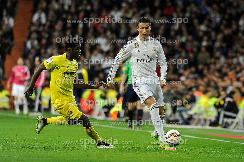 01.03.2015, Estadio Santiago Bernabeu, Madrid, ESP, Primera Division, Real Madrid vs FC Villarreal, 25. Runde, im Bild Real Madrid&acute;s Cristiano Ronaldo and Villarreal CF&acute;s Joel Campbell // during the Spanish Primera Division 25th round match between Real Madrid CF and Villarreal at the Estadio Santiago Bernabeu in Madrid, Spain on 2015/03/01. EXPA Pictures &copy; 2015, PhotoCredit: EXPA/ Alterphotos/ Luis Fernandez<br /> <br /> *****ATTENTION - OUT of ESP, SUI*****