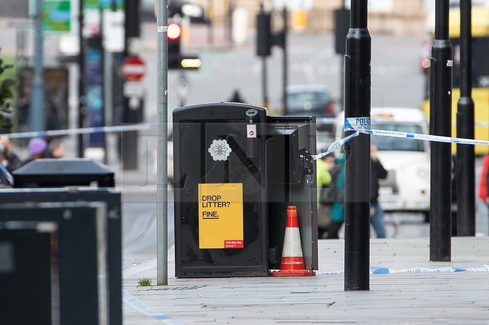 © Licensed to London News Pictures. 11/10/2019. Manchester, UK. A bin surrounded by police tape and with a police cone beside it on Exchange Square at the foot of the steps to the Arndale Centre . Terrorism Police are investigating after four people were stabbed during a single attack at the Arndale Centre in Manchester City Centre . Photo credit: Joel Goodman/LNP