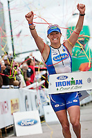 JEROME A. POLLOS/Press..Tyler Stewart celebrates as she secures her title as the top female finisher of  Sunday's Ford Ironman Coeur d'Alene. Stewart, from Novato, Calif., set a new records for the bicycle course and the top overall course time for females with a final time of 9:23:21.