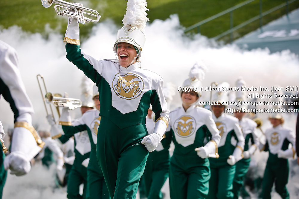 SHOT 10/12/13 1:15:26 PM - Colorado State marching band members lead the football team onto the field before a game against San Jose State during their regular season Mountain West game at Hughes Stadium in Fort Collins, Co. San Jose State won the game 34-27. (Photo by Marc Piscotty / © 2013)