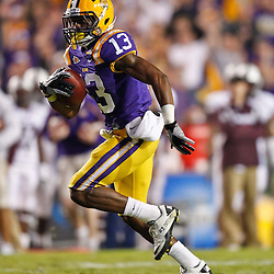November 13, 2010; Baton Rouge, LA, USA; LSU Tigers cornerback Ron Brooks (13) returns an interception back for a touchdown during the first half against the Louisiana Monroe Warhawks at Tiger Stadium.  Mandatory Credit: Derick E. Hingle