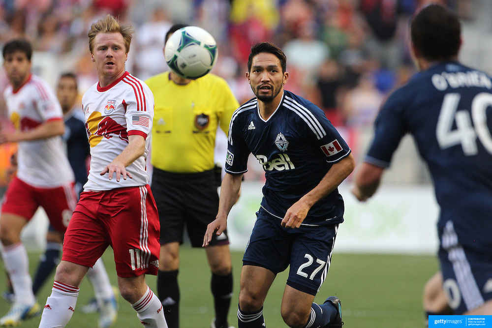 Jun Marques Davidson, Vancouver Whitecaps, is challenged by Dax McCarty, New York Red Bulls, during the New York Red Bulls V Vancouver Whitecaps FC, Major League Soccer regular season match at Red Bull Arena, Harrison, New Jersey. USA. 1st June 2013. Photo Tim Clayton