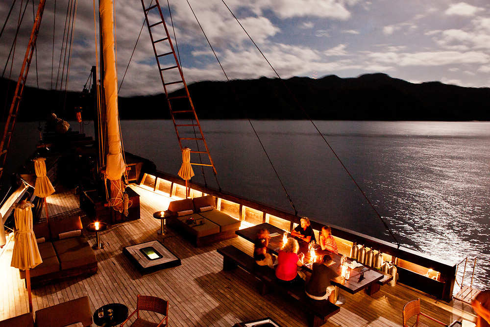 Dinner on deck in the full moom on Alila Purnama.