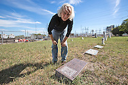 """Oct 9th, 2013, Fort Worth, Don Young at his fathers burial site in a cemetery that has leassed its' mineral rights to a fracking company. . Forth Worth has 1200 frack sites.  Hydraulic fracturing, or """"fracking"""", is the process of drilling and injecting fluid into the ground at a high pressure in order to fracture shale rocks to release natural gas underground."""