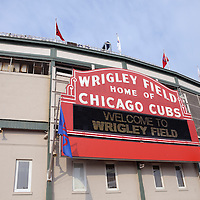 Wrigley Field sign for the Chicago Cubs. Wrigley Field built in 1914 and is also referred to as The Friendly Confines. High resolution prints and stock photos are available.