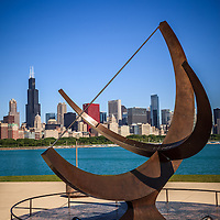 Chicago Adler Planetarium sundial named Man Enters the Cosmos with the Chicago downtown skyline and Willis Tower (Sears Tower) in the background.