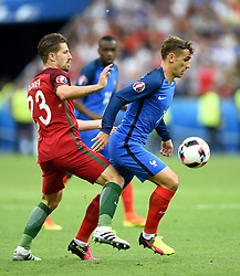 Adrien Silva of Portugal battles for the ball with Antoine Griezmann of France  - Mandatory by-line: Joe Meredith/JMP - 10/07/2016 - FOOTBALL - Stade de France - Saint-Denis, France - Portugal v France - UEFA European Championship Final