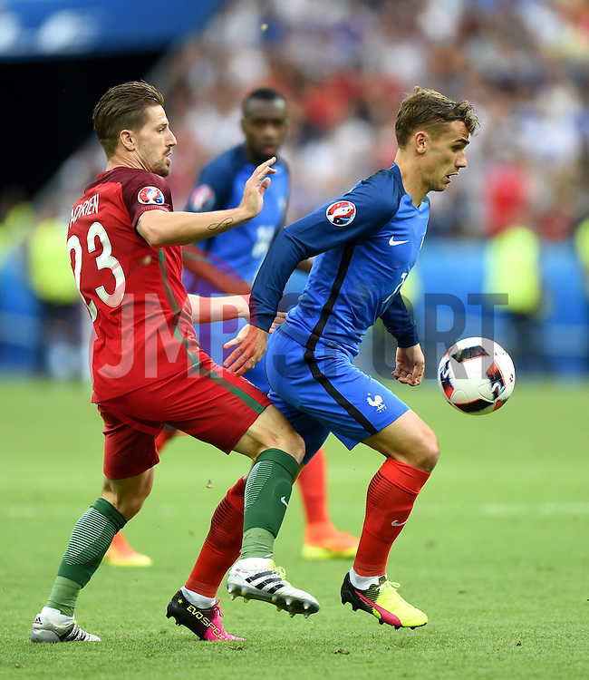 Adrien Silva of Portugal battles for the ball with Antoine Griezmann of France  - Mandatory by-line: Joe Meredith/JMP - 10/07/2016 - FOOTBALL - Stade de France - Saint-Denis, France - Portugal v France - UEFA European Championship Final
