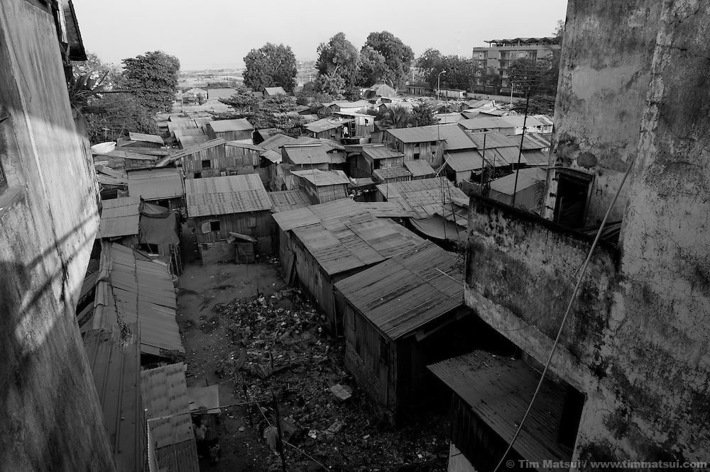 """Life in a slum where the non governmental organization """"Acting for Women in Distressing Situations"""" (AFESIP), conducts outreach and provides services in Phnom Penh, Cambodia. The permanent structure, a decaying four story building known simply as 'The Building', was built in the 1960's as transitional housing and now hosts a shantytown where many of the city's poor live, including many prostitutes, and is believed to have the highest rate of HIV infection in the city. AFESIP hands out free condoms, instructs prostitutes on HIV prevention, and conducts outreach in case the prostitutes need medical services, choose to leave their profession, or can report on cases of sex trafficking. AFESIP offers housing, education, training, and counseling for women who are victims of sex trafficking, worked as prostitutes, or are escaping domestic violence. Founded by Somaly Mam, who herself was once a prostitute and victim of trafficking and domestic abuse, AFESIP has three facilities in Cambodia and works with other NGO's to provide long term care for the women."""