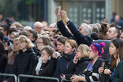 © Licensed to London News Pictures . 14/10/2016 . Manchester , UK . Crowds watch as the Duke and Duchess of Cambridge lay a wreath during a service at the Cenotaph at Manchester Town Hall during a dedication service , on their visit in Manchester . Photo credit : Joel Goodman/LNP