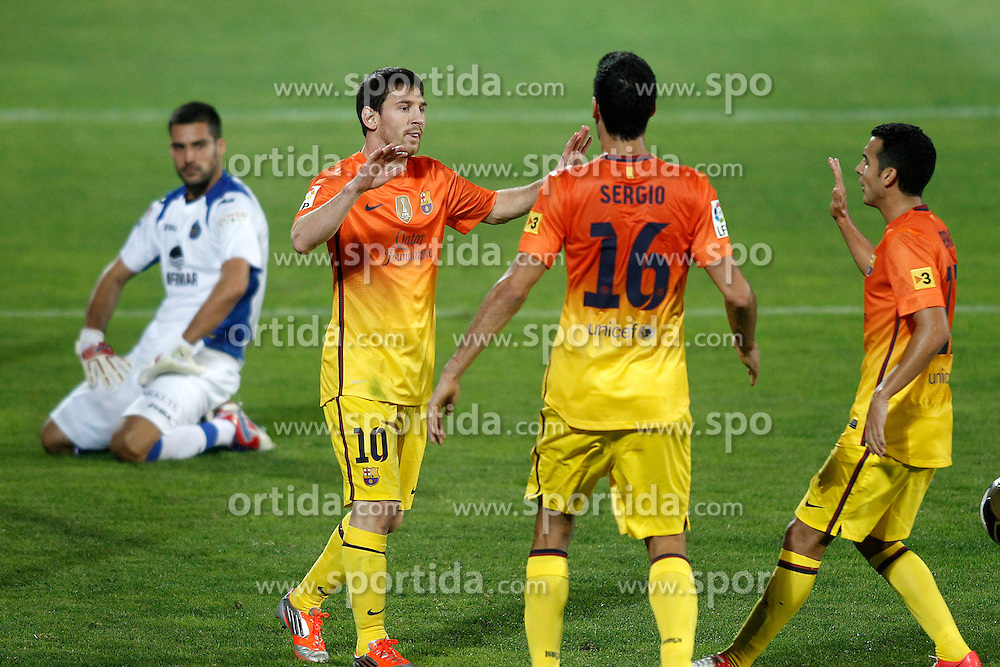 15.09.2012, Coliseum Alfonso Perez, Getafe, ESP, Primera Division, FC Getafe vs FC Barcelona, 04. Runde, im Bild FC Barcelona's Lionel Messi, Sergio Busquets and Pedro Rodriguez celebrate goal in presence of Getafe's Miguel Angel Moya (l) dejected // during the Spanish Primera Division 04th round match between Getafe CF and Barcelona FC at the Coliseum Alfonso Perez, Getafe, Spain on 2012/09/15. EXPA Pictures © 2012, PhotoCredit: EXPA/ Alterphotos/ Acero..***** ATTENTION - OUT OF ESP and SUI *****